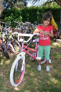 Two lucky kids came to Centennial Park to pick out their bikes and help with the handover!